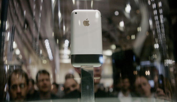 The new iPhone sits on display behind a glass case at the Macworld conference in San Francisco