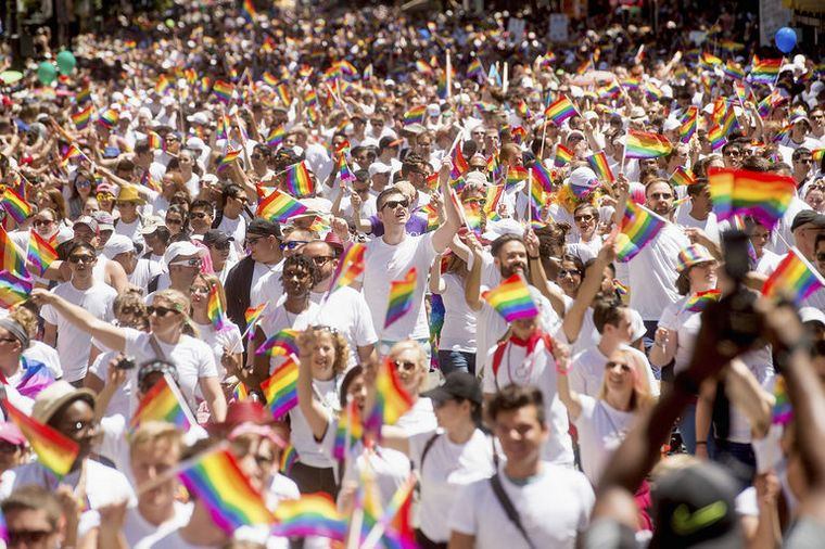 Apple employees carry rainbow flags as they march in the San Francisco Gay Pride Festival in California June 29, 2014.