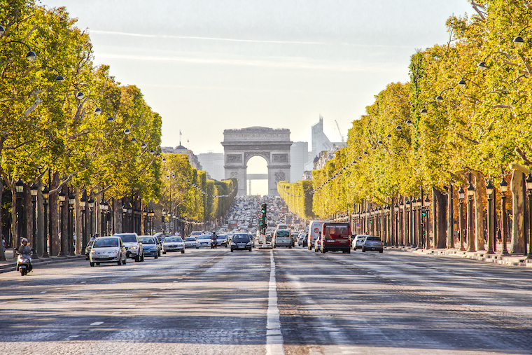 PARIS, FRANCE - SEPTEMBER 9: The Champs-Elysees and the Arc de Triomphe, on September 09, 2012 in Paris, France. The most famous street of Paris has 1910m and is full of stores, cafés and restaurants.