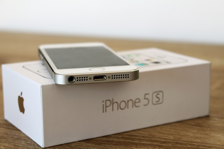 Modern white iPhone 5s on the original box